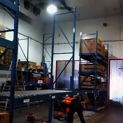 warehouse-handyman-installing-shelving Complete Warehouse Handyman & Maintenance Service